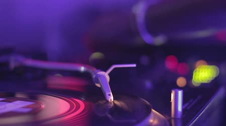 rpm : Female dj playing music at the mixer. Stylus on the vinyl record. Night club