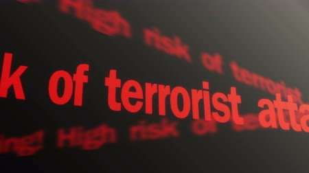 counterterrorism : Warning, high risk of terrorist attacks. Red security text running on LED sign