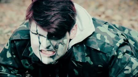 frightful : Scary man in military uniform crawling in forest, zombie invasion, horror movie