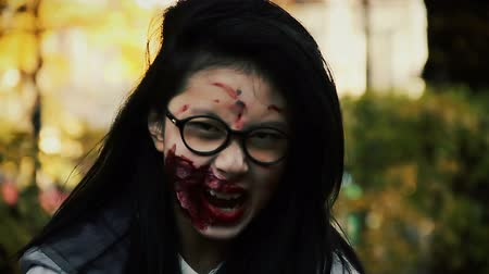 frightful : Terrible female zombie looking aggressively into camera, scary bloody vampire