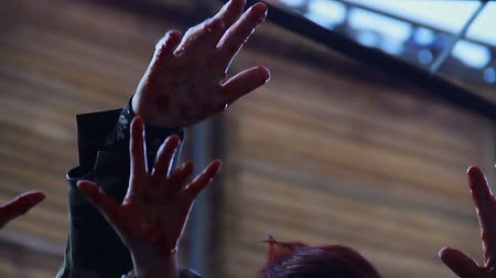 bloodshed : Bloody hands of scary monsters shaking in air, threatening to kill victim