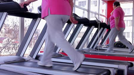 nadváha : Tired overweight woman sweating on treadmill after intensive workout in the gym Dostupné videozáznamy