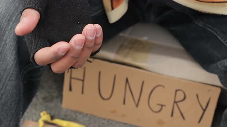 pieski : Homeless person begging with outstretched trembling hand, poverty and misery