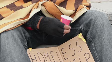 dole : Poor man begging, shaking cup to draw attention, people giving money to homeless