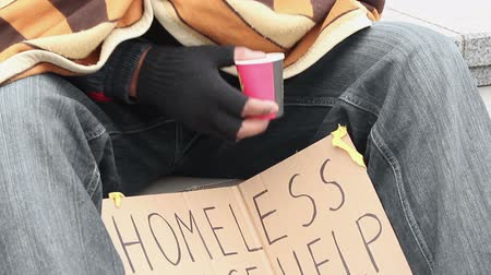 dole : Frozen homeless man covered with blanket, begging money, holding paper cup