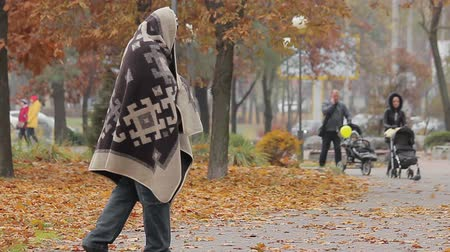 deprived : Unhappy beggar limping in autumn park, social vulnerability and poverty problem