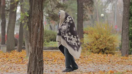 deprived : Lonely poor man limping in park, strange man covered with blanked needs help Stock Footage