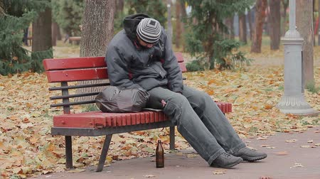 shameful : Disgusting drunk man sleeping and coughing on bench in city park, alcohol addict