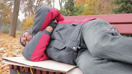 shameful : Male addicted to alcohol sleeping on bench, drunk man suffering from hangover