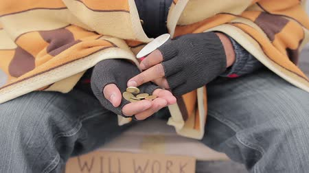 deprived : Hands of miserable beggar counting charity money given by kindhearted people
