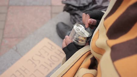 deprived : Socially vulnerable homeless person eating canned food in street, poverty issue