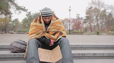 deprived : Poor man asking for charity in city park, miserable homeless person needs help
