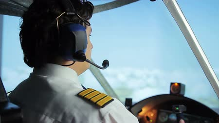 aircrew : Airliner crew commander navigating plane in blue sky, passenger transportation Stock Footage