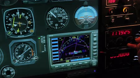 fülke : Flight control panel showing altitude and speed details, pilot switching radio Stock mozgókép