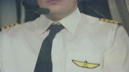 aircrew : Pilots insignia on uniform, captain controlling airliner, thinking about home