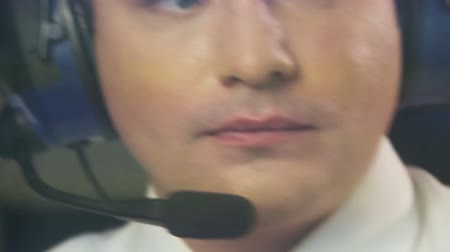 aircrew : Tired pilot in headset navigating commercial plane, responsibility, commitment Stock Footage