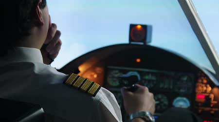 pilot in command : Male pilot flying in autopilot mode, transmitting information by walkie-talkie Stock Footage