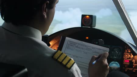 aircrew : Plane captain writing down information in flight plan, autopilot, transportation