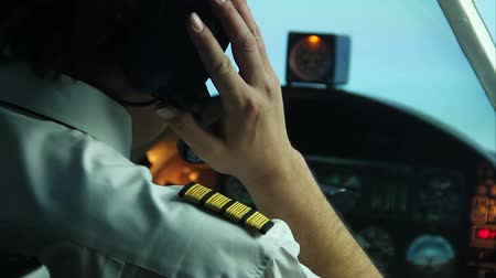 pilot in command : Pilot flying commercial plane, transmitting information by walkie-talkie