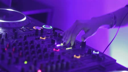 tweaking : Female deejay performing at nightclub party, mixing music records for public