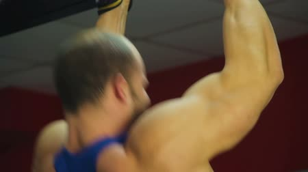 мышечный : Strong muscular arm of male athlete doing pull-ups, training before competition Стоковые видеозаписи