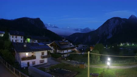 faház : Night falling on beautiful comfy cottages in mountain area, European village Stock mozgókép