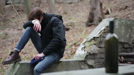unrequited : Emotional man crying in sorrow, suffering bad time in life, addiction to alcohol