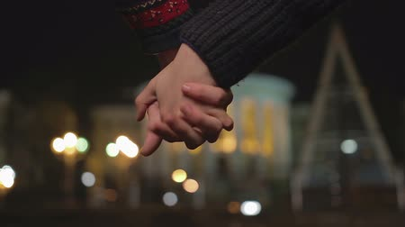 interlock : Young couple holding hands, interlocking fingers passionately, romantic date Stock Footage