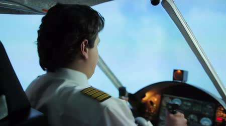 feszült : Aircraft flying into turbulence zone, pilot maneuvering plane, hazardous job Stock mozgókép