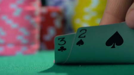 Ко : Person having bad combination in poker, weak hand. Losing money, bankruptcy Стоковые видеозаписи