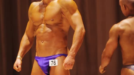 possession : Bodybuilders leaving stage during contest, professional sport, motivation