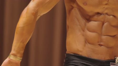 enduring : Perfect muscular six-pack abs, result of enduring workouts and exercising in gym