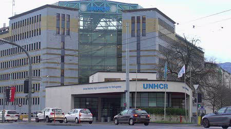 sürgün : United Nation Refugee Agency office in Geneva, Switzerland, migration issues Stok Video