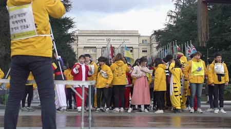 азиаты : Young Asians in various costumes posing for group photo near UN Office at Geneva