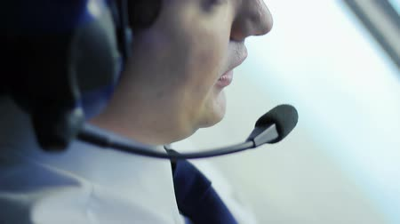 pilot in command : Attentive pilot navigating airplane, transmitting information to dispatcher Stock Footage