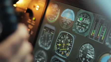 aircrew : Flight control desk with changing indicators, pilots hands on steering wheel