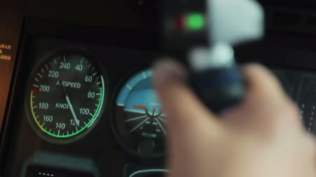 refocus : Rack focus of pilot hands steering plane and flight display with speedometer