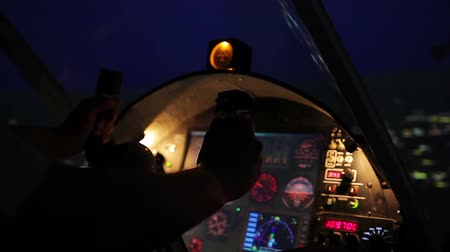 chartered : Night flight above city, professional pilot navigating plane, air transportation
