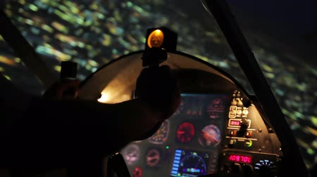 chartered : Attentive airman maneuvering private plane at evening time, cool view on city
