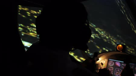 nightcity : Beautiful view on night city from cockpit, attentive pilot flying airplane Stock Footage