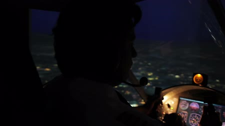 nightcity : Flight above evening city, exhausted chief pilot steering aircraft in dark cabin