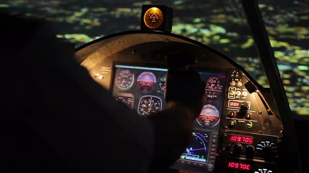 nightcity : Pilots hands on steering wheel, night flight, airplane hovering above city Stock Footage