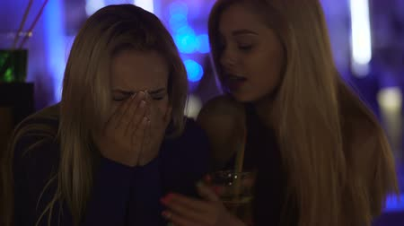 insincere : Young woman crying and talking sad emotions away to perfidious female friend
