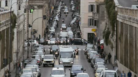 crossway : Traffic jam in European city, cars moving slowly in lanes, transportation system