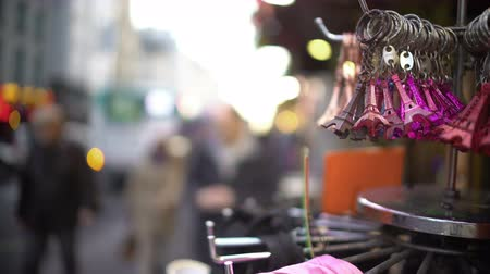 bugiganga : Keychains and souvenirs hanging on stand, tourism and shopping in Paris Stock Footage