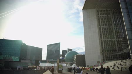 arche : Tourists walking near beautiful monument Grande Arche de la Defense in Paris