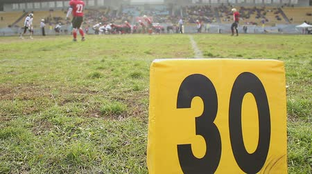 take offense : American football match, players ready for ball snap scrimmage, 30-yard line Stock Footage