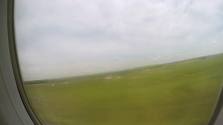 aerodrome : Aircraft taking off runway, gaining altitude in air, green landscape in window