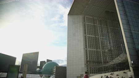 arche : View on Grande Arche de la Defense and modern glass buildings in Paris, France Stock Footage