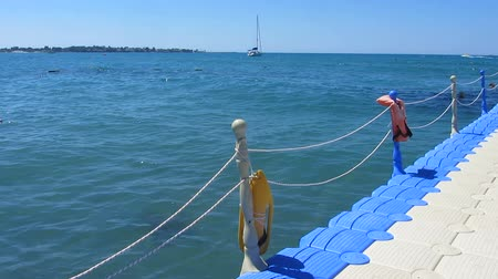 levee : Floating pier near the sea, yachting, sailing, summer outdoor activities Stock Footage